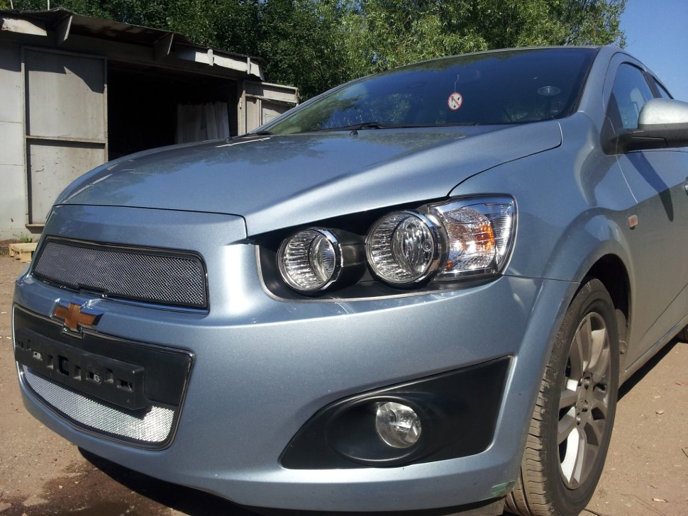 Защита радиатора Chevrolet Aveo 2012- chrome низ. Фото N2